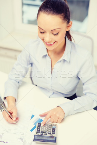 businesswoman working with documents in office Stock photo © dolgachov