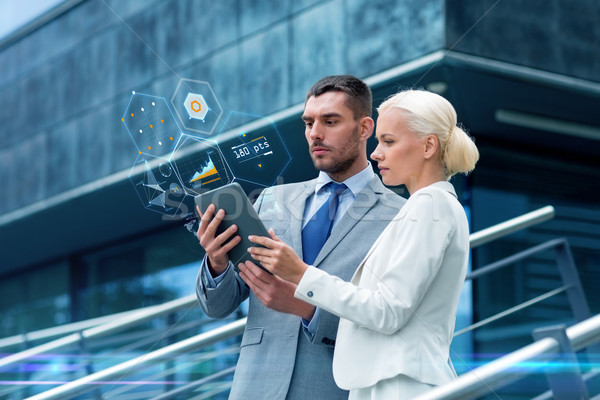 businesspeople with tablet pc outdoors Stock photo © dolgachov