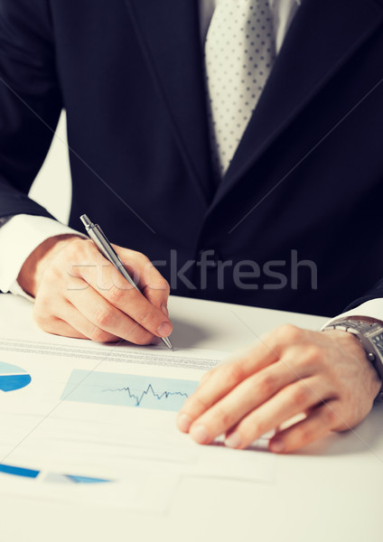 businessman working and signing paper Stock photo © dolgachov