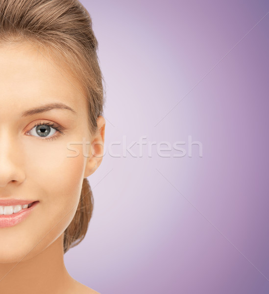 close up of beautiful young woman half face Stock photo © dolgachov