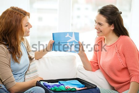 close up of happy lesbian couple with rainbow flag Stock photo © dolgachov