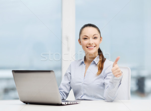 Stock photo: businesswoman with laptop in office