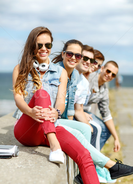 teenage girl hanging out with friends outdoors Stock photo © dolgachov