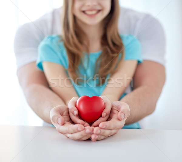 close up of man and girl holding red heart shape Stock photo © dolgachov