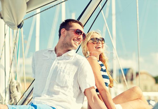 Lächelnd Paar Sitzung Yacht Deck Urlaub Stock foto © dolgachov
