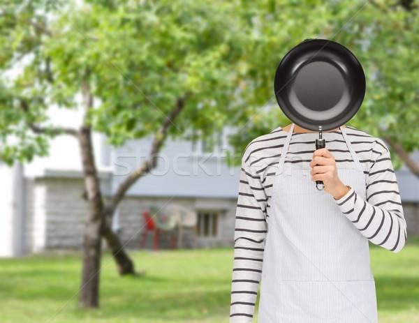 Man kok schort verbergen gezicht achter Stockfoto © dolgachov