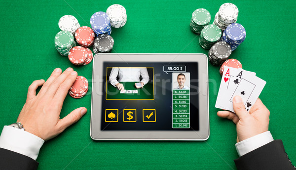 casino player with cards, tablet pc and chips Stock photo © dolgachov