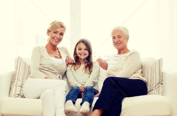 smiling family at home Stock photo © dolgachov