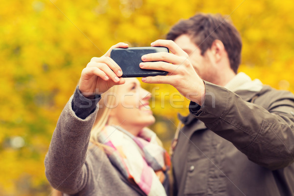 Couple smartphone parc technologie amour Photo stock © dolgachov