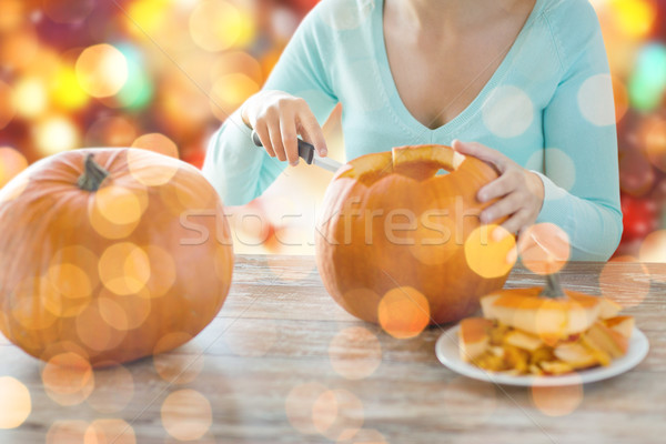 close up of woman carving pumpkins for halloween Stock photo © dolgachov