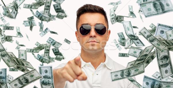 man pointing on you with falling dollar money Stock photo © dolgachov