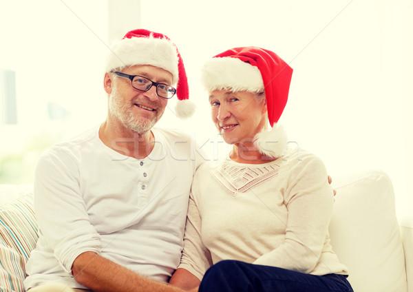Boldog idős pár mikulás segítő sapkák otthon Stock fotó © dolgachov