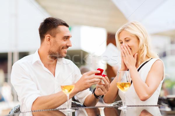 Boldog pár eljegyzési gyűrű bor kávézó szeretet Stock fotó © dolgachov