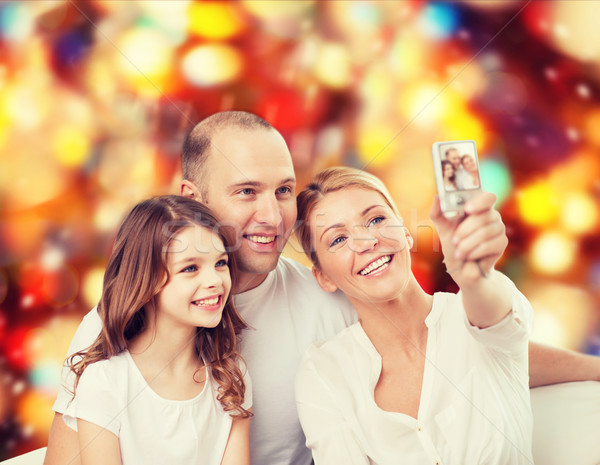 happy family with camera at home Stock photo © dolgachov