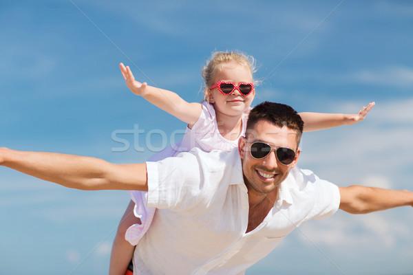 happy family having fun over blue sky background Stock photo © dolgachov