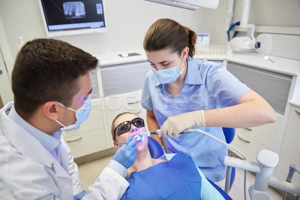 Diş hekimleri erkek hasta dişler klinik insanlar Stok fotoğraf © dolgachov