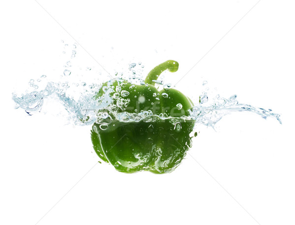 pepper falling or dipping in water with splash Stock photo © dolgachov