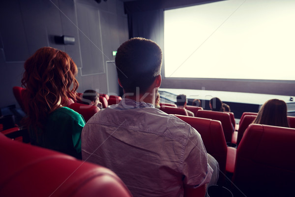 happy couple watching movie in theater or cinema Stock photo © dolgachov