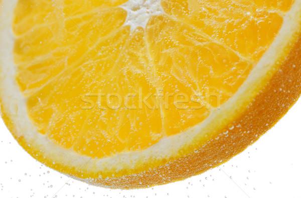 Orange slice vallen water vruchten voedsel gezond eten Stockfoto © dolgachov