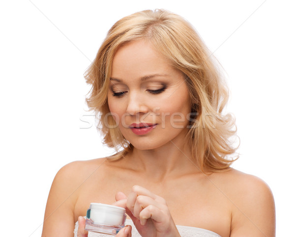 middle aged woman with cream jar Stock photo © dolgachov