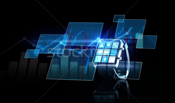 close up of smartwatch with app icons and chart Stock photo © dolgachov