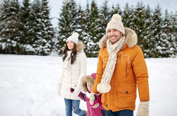 happy family in winter clothes walking outdoors Stock photo © dolgachov