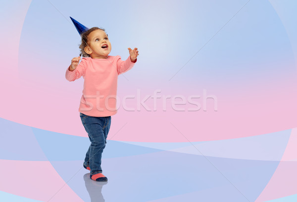 happy little baby girl with birthday party hat Stock photo © dolgachov