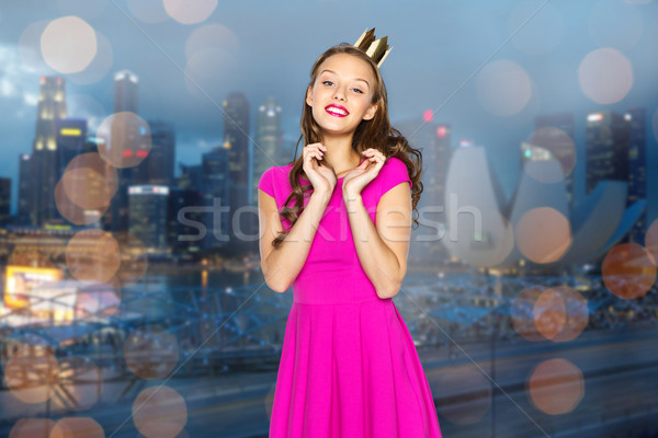 happy young woman or teen girl in pink dress Stock photo © dolgachov