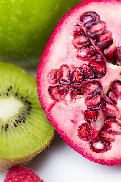 close up of ripe pomegranate and kiwi Stock photo © dolgachov