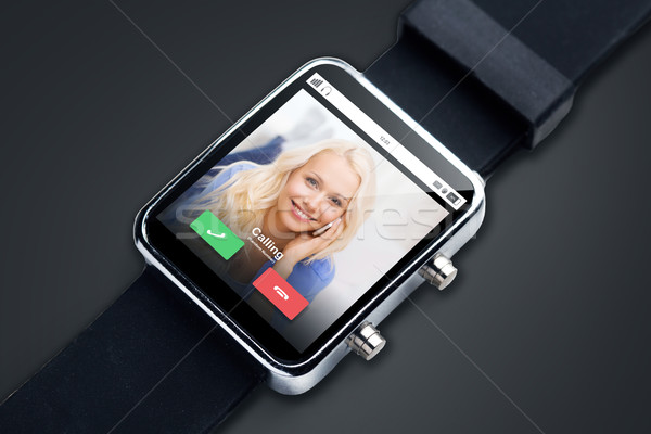 close up of black smart watch with incoming call Stock photo © dolgachov