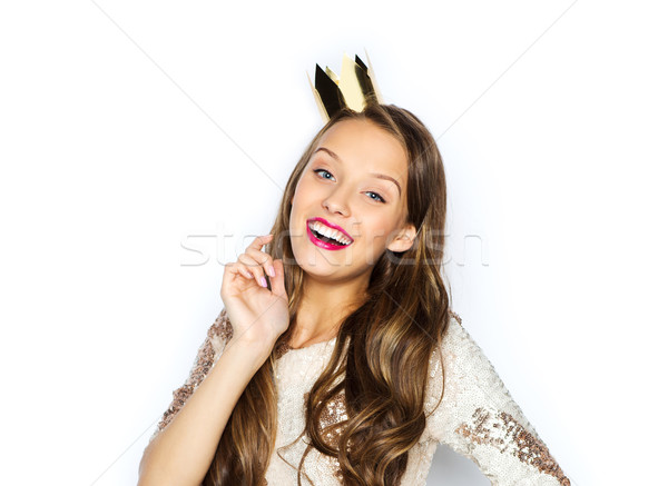 happy young woman or girl in party dress and crown Stock photo © dolgachov