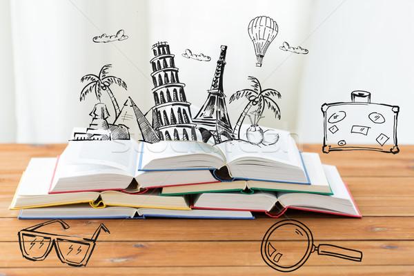 Közelkép könyvek asztal firkák oktatás utazás Stock fotó © dolgachov