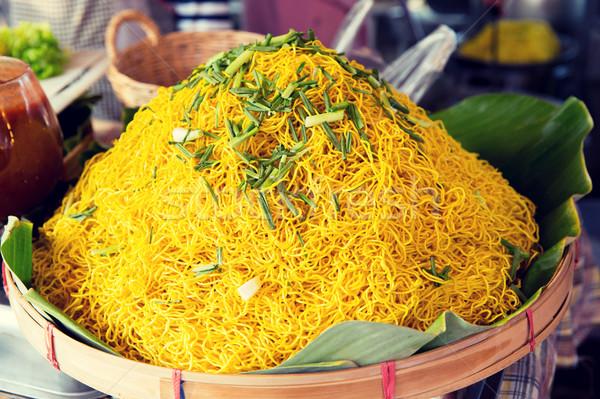 cooked noodles at street market Stock photo © dolgachov
