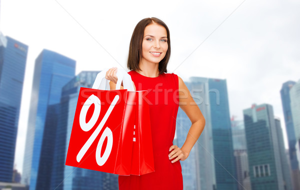 happy woman with shopping bags over singapore city Stock photo © dolgachov