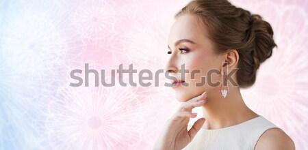 Közelkép gyönyörű nő arc fülbevaló báj szépség Stock fotó © dolgachov