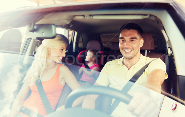 happy family with little child driving in car Stock photo © dolgachov