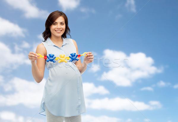 Szczęśliwy kobieta w ciąży zabawki ciąży Zdjęcia stock © dolgachov