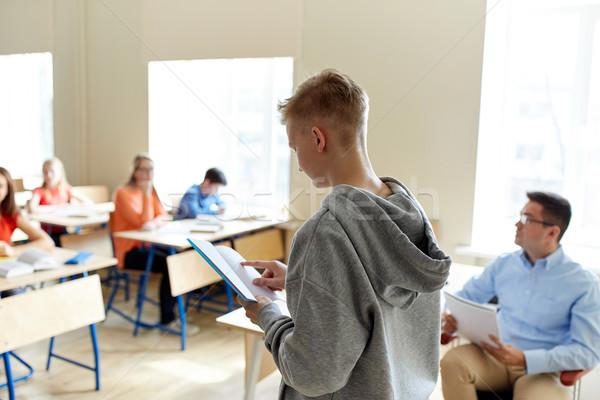 Diák fiú notebook tanár iskola oktatás Stock fotó © dolgachov