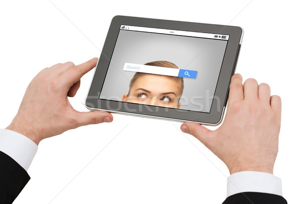 close up of hands holding tablet pc with Stock photo © dolgachov