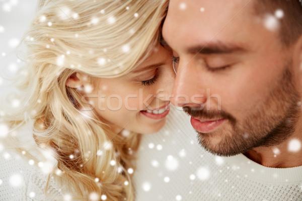 close up of happy couple faces with closed eyes Stock photo © dolgachov