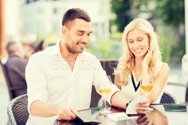 счастливым пару бумажник законопроект ресторан дата Сток-фото © dolgachov
