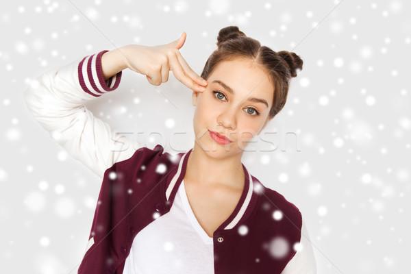 S'ennuie adolescente doigt fusil geste Photo stock © dolgachov