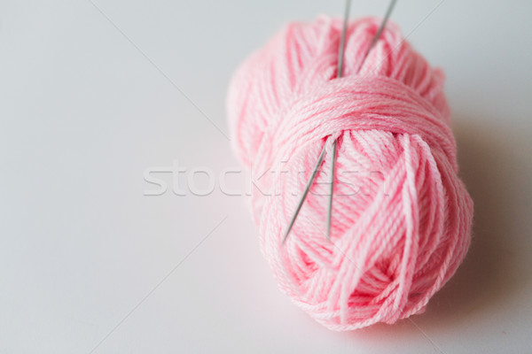 knitting needles and ball of pink yarn Stock photo © dolgachov