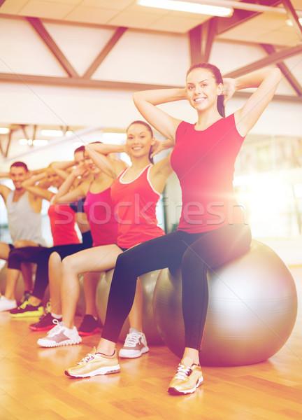 Grup insanlar pilates sınıf uygunluk spor Stok fotoğraf © dolgachov