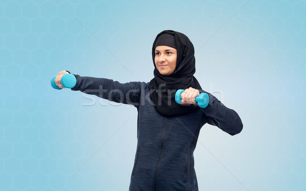 muslim woman in hijab with dumbbells doing fitness Stock photo © dolgachov