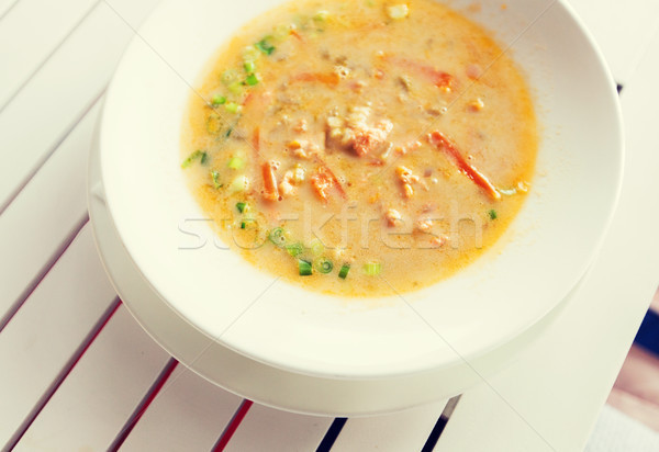 close up of cream soup plate on table Stock photo © dolgachov