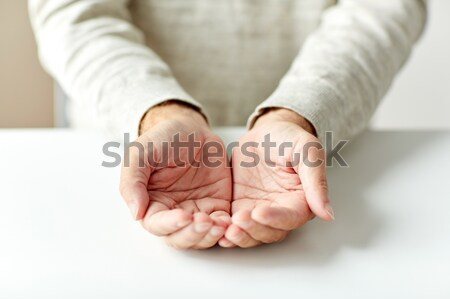 close up of empty senior man hands Stock photo © dolgachov