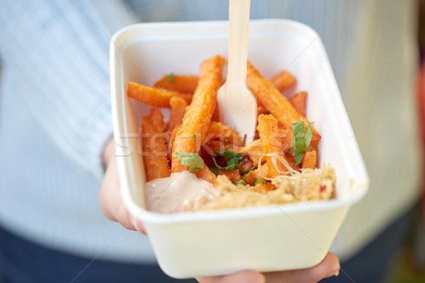 close up of hand holding plate with sweet potato Stock photo © dolgachov
