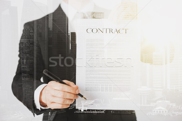 close up of businessman holding contract paper Stock photo © dolgachov