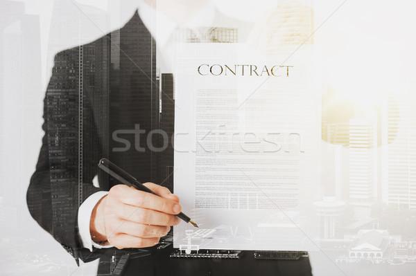 Közelkép üzletember tart szerződés papír emberek Stock fotó © dolgachov